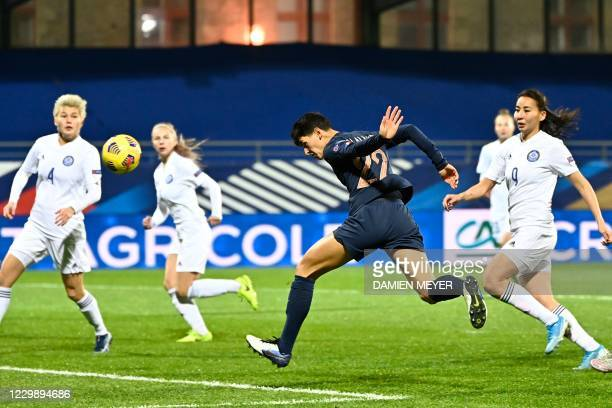Frances defender Elisa De Almeida heads the ball and scores a goal during the Women's UEFA Euro 2022 Group G qualifier football match between France...