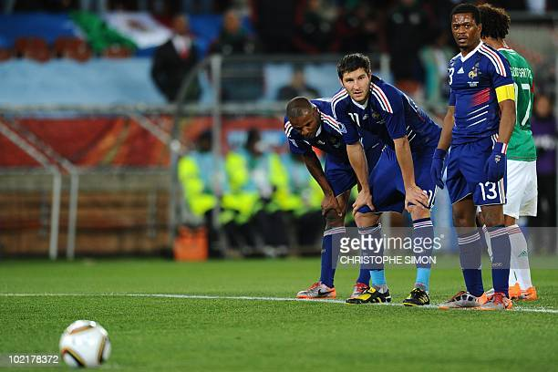 France's defender Eric Abidal France's striker AndrePierre Gignac and France's defender Patrice Evra look on before Mexico's striker Cuauhtemoc...