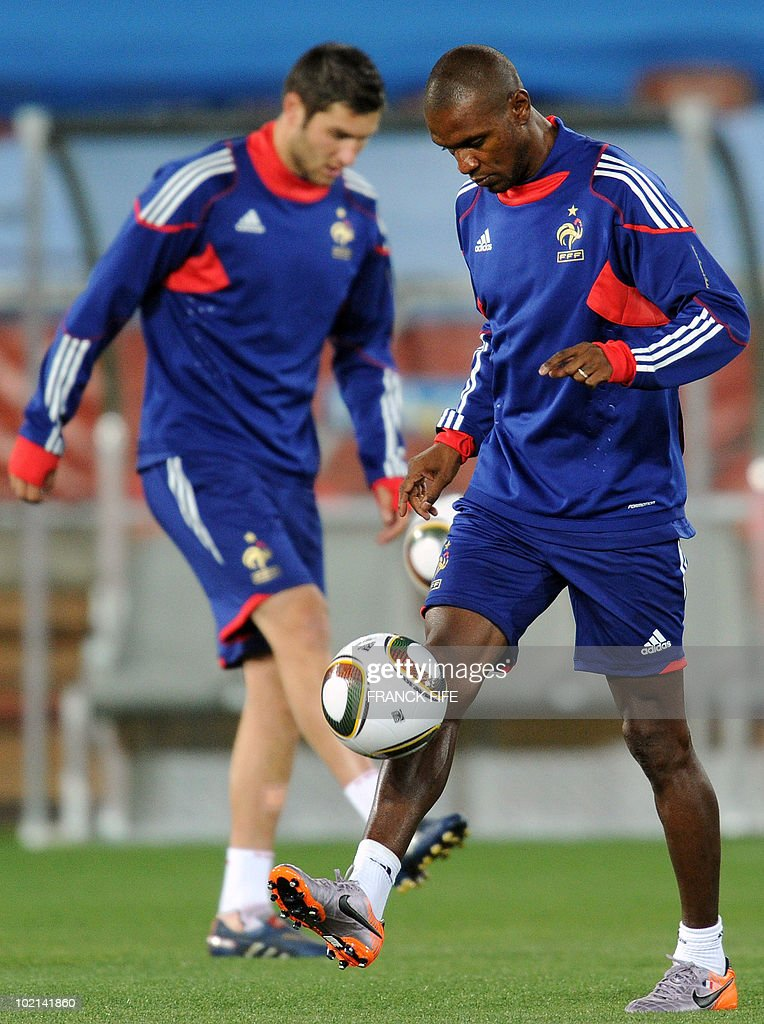 France's defender Eric Abidal (R) juggles a ball during a training session at the Peter Mokaba stadium in Polokwane on June 16, 2010. France will play against Mexico in their second first-round 2010 World Cup football match on June 17.