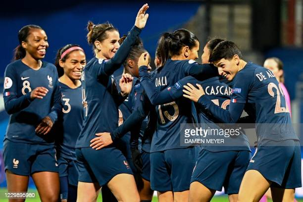 Frances defender Estelle Cascarino is congratulated by teammates after scoring the team's eighth goal during the Women's UEFA Euro 2022 Group G...