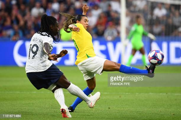TOPSHOT France's defender Griedge Mbock Bathy vies with Brazil's forward Marta during the France 2019 Women's World Cup round of sixteen football...