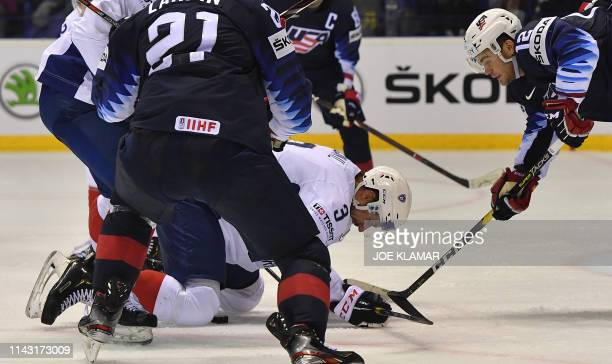 TOPSHOT France's defender Jonathan Janil and United States' forward Alex Debrincat vie for the puck during the IIHF Men's Ice Hockey World...