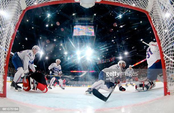 France's defender Kevin Hecquefeuille and France's forward Antoine Roussel react during the IIHF Men's World Championship group B ice hockey match...