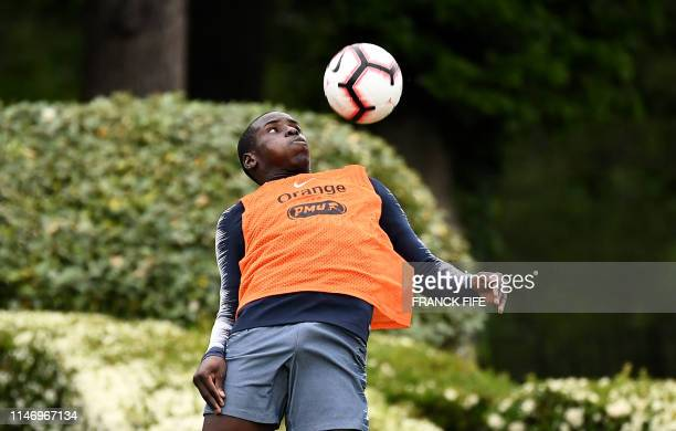 France's defender Kurt Zouma controls the ball during a training session in ClairefontaineenYvelines southwest of Paris on May 30 as part of the...