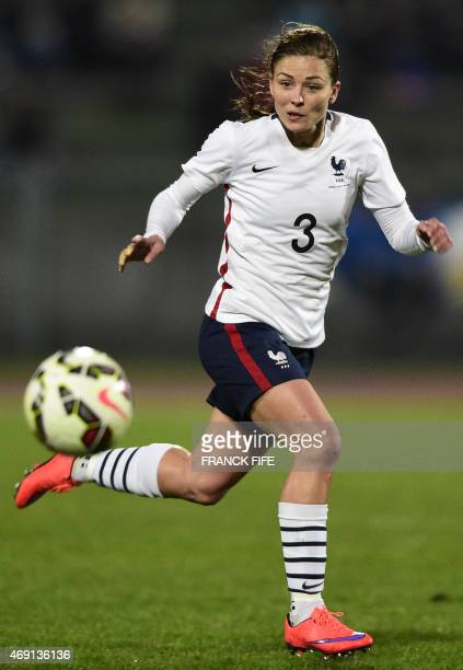 France's defender Laure Boulleau controls the ball during the friendly football match France vs Canada on April 9 2015 at the Stade RobertBobin...