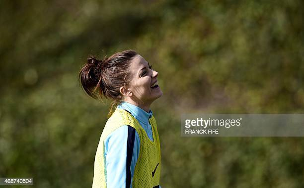 France's defender Laure Boulleau smiles during a training session in Clairefontaine en Yvelines southwest of Paris on April 6 ahead of the friendly...
