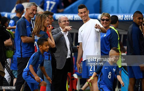 France's defender Laurent Koscielny and his wife Claire Koscielny are pictured at the end of the Euro 2016 round of 16 football match between France...