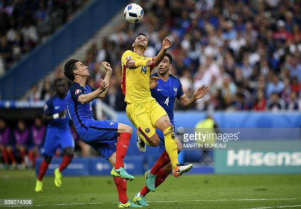 France's defender Laurent Koscielny vies for the ball with Romania's forward Florin Andone during the Euro 2016 group A football match between France...