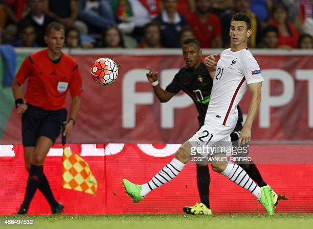 France's defender Laurent Koscielny vies with Portugal's forward Nani during the Euro 2016 friendly football match Portugal vs France at the Jose...