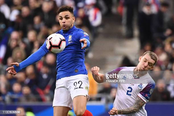 France's defender Layvin Kurzawa and Iceland's defender Birkir Saevarsson vie for the ball during the UEFA Euro 2020 Group H qualification football...