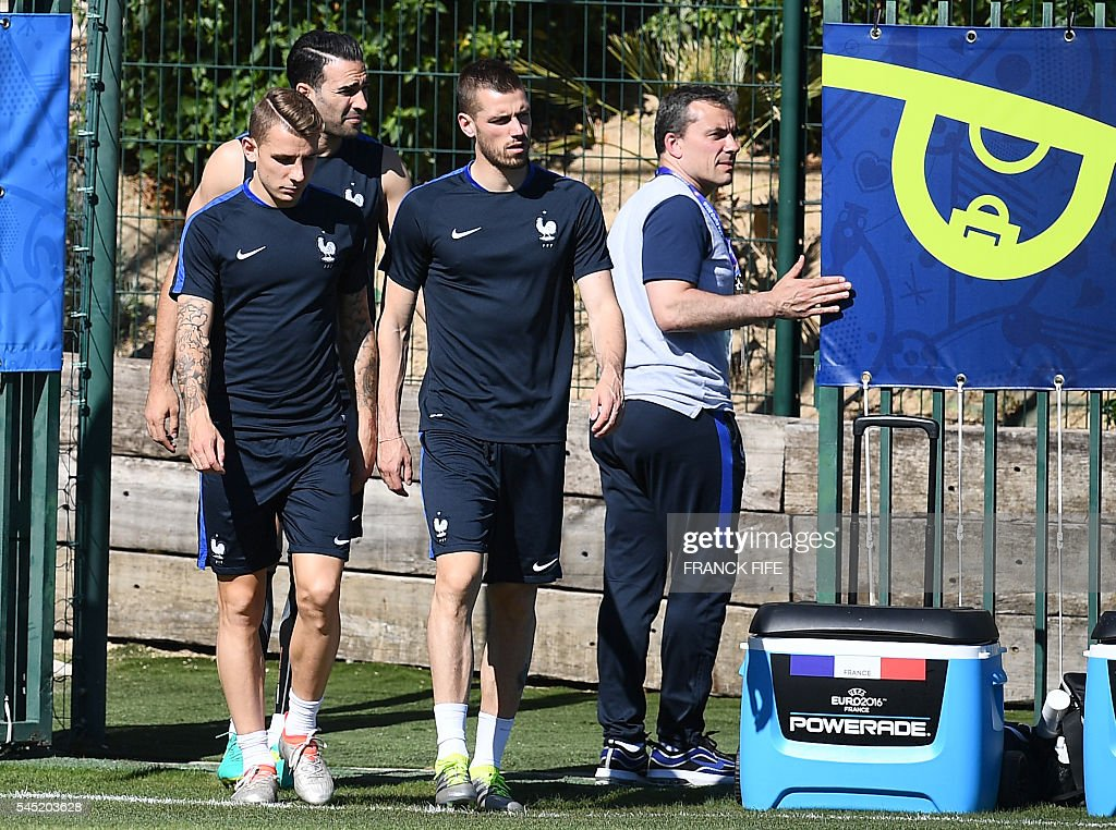 France's defender Lucas Digne, France's defender Adil Rami and France's midfielder Morgan Schneiderlin arrive for a training session in the southern French city of Marseille on July 6, 2016 on the eve of their Euro 2016 Semi-Final match against Germany. France coach Didier Deschamps has called on Les Bleus to go on the attack to end a 58-year wait to beat Germany in a major tournament and book a spot in the Euro 2016 final. / AFP / FRANCK