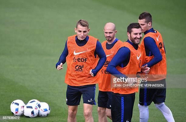 France's defender Lucas Digne France's defender Christophe Jallet France's forward AndréPierre Gignac and France's midfielder Morgan Schneiderlin...
