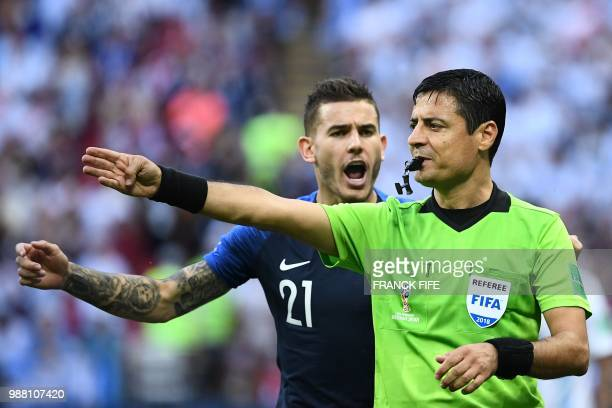 France's defender Lucas Hernandez argues with Irani referee Alireza Faghani during the Russia 2018 World Cup round of 16 football match between...