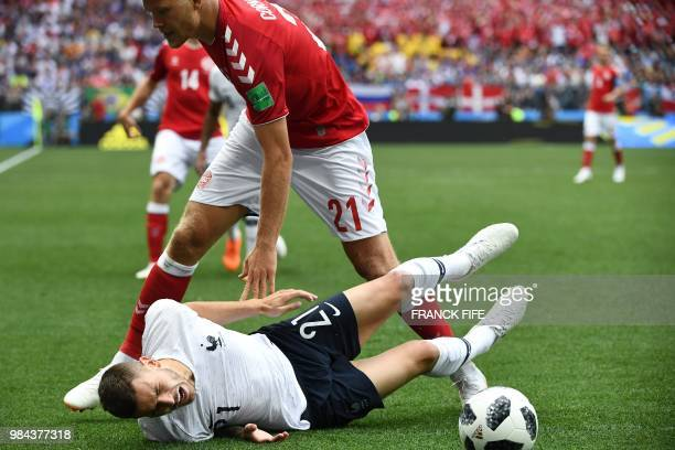 France's defender Lucas Hernandez falls beside Denmark's forward Andreas Cornelius during the Russia 2018 World Cup Group C football match between...