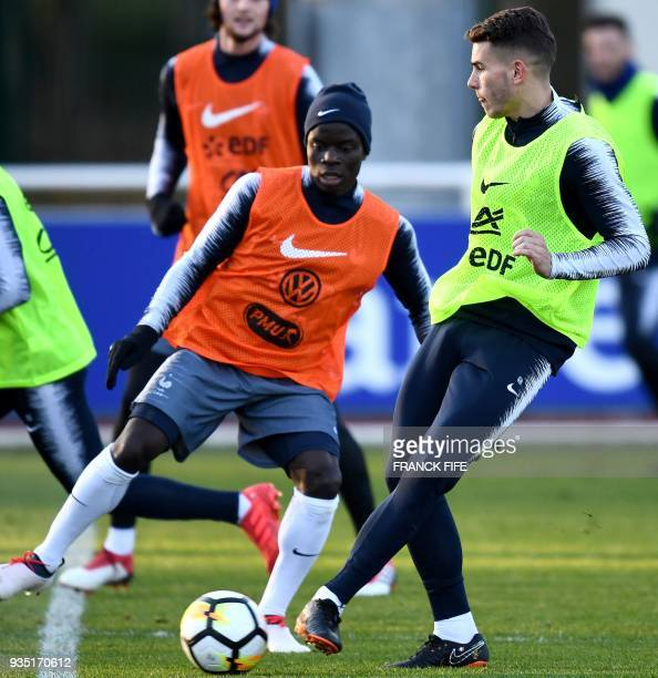 France's defender Lucas Hernandez vies with France's midfielder N'Golo Kante during a training session in Clairefontaine en Yvelines on March 20 as...