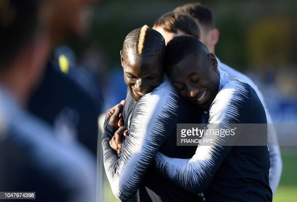 France's defender Mamadou Sakho jokes with France's midfielder Blaise Matuidi during a training session in Clairefontaine en Yvelines on October 8...