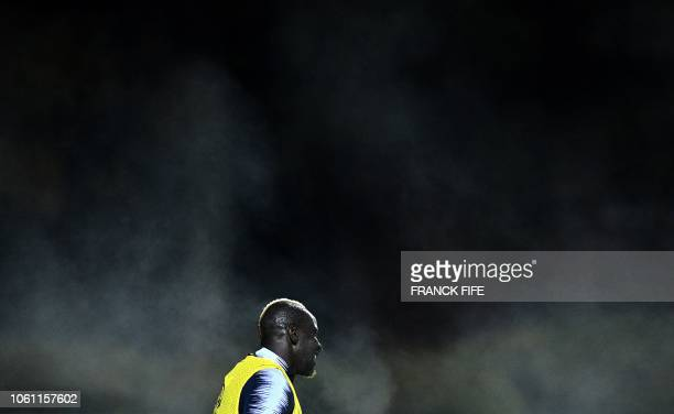 France's defender Mamadou Sakho takes part in a training session in Clairefontaine-en-Yvelines, near Paris, on November 13 as part of the team's...