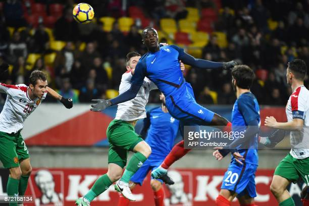 France's defender Mouctar Diakhaby vies with Bulgaria's midfielder Antonio Vutov and Bulgaria's defender Ventsislav Vasilev during the Euro 2019 U21...