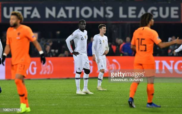 France's defender Moussa Sissoko and France's defender Benjamin Pavard react after losing the UEFA Nations League football match between the...