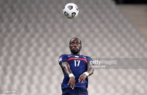 France's defender Moussa Sissoko heads the ball during the UEFA Nations League Group C football match between France and Croatia on September 8, 2020...