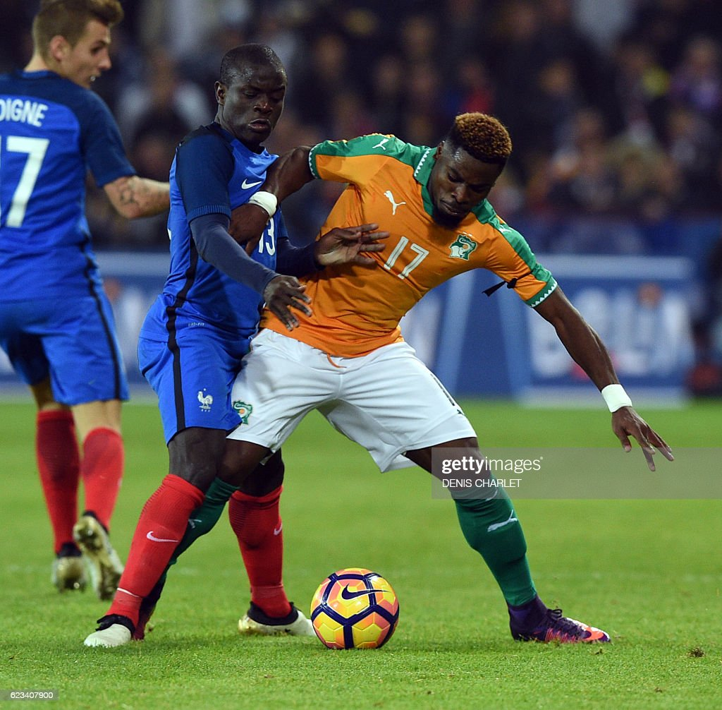 France's defender N'Golo Kante (L) vies with Ivory Coast's defender Serge Aurier during the friendly football match France vs Ivory Coast on November 15, 2016 at the Bollaert stadium in Lens. / AFP / DENIS