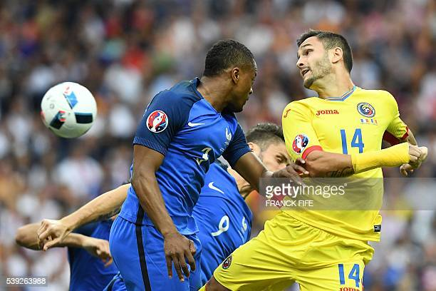 France's defender Patrice Evra and Romania's forward Florin Andone vie for the ball during the Euro 2016 group A football match between France and...