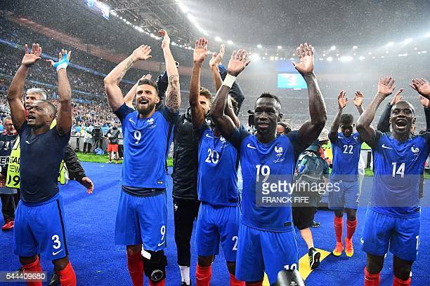 France's defender Patrice Evra forward Olivier Giroud forward Kingsley Coman and France's defender Bacary Sagna France's defender Samuel Umtiti and...