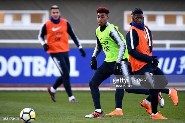 France's defender Presnel Kimpembe plays the ball next to France's forward Ousmane Dembele during a training session in Clairefontaine en Yvelines on...