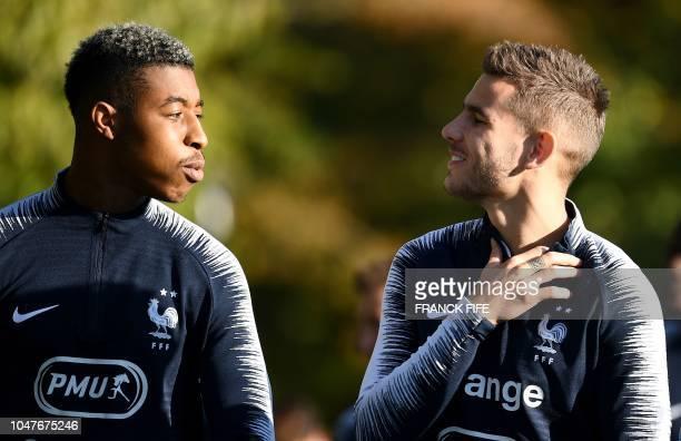 France's defender Presnel Kimpembe speaks with France's defender Lucas Hernandez before a training session in Clairefontaine en Yvelines on October 8...