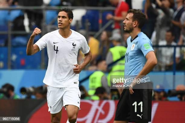 France's defender Raphael Varane celebrates a goal past Uruguay's forward Cristhian Stuani during the Russia 2018 World Cup quarterfinal football...