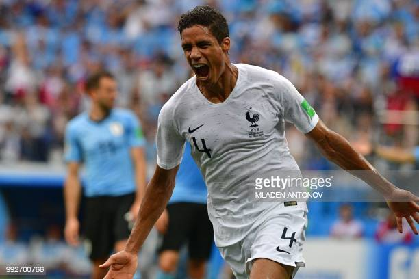 France's defender Raphael Varane celebrates after scoring the opener during the Russia 2018 World Cup quarterfinal football match between Uruguay and...