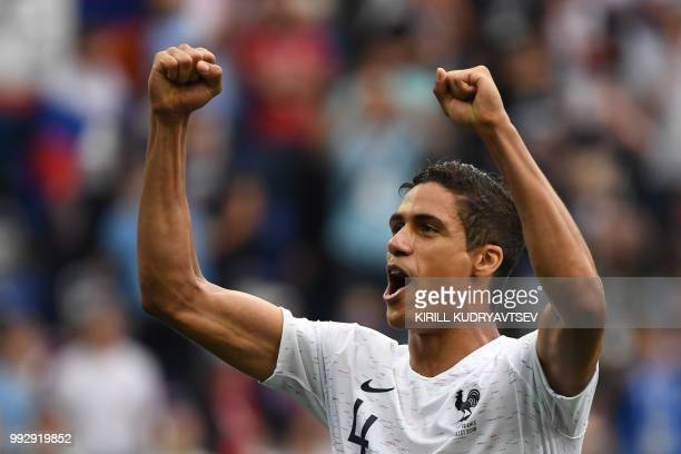 France's defender Raphael Varane celebrates their victory at the end of the Russia 2018 World Cup quarterfinal football match between Uruguay and...