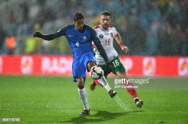 France's defender Raphael Varane controls the ball ahead of Bulgaria's midfielder Andrey Galabinov during the FIFA World Cup 2018 qualifying football...