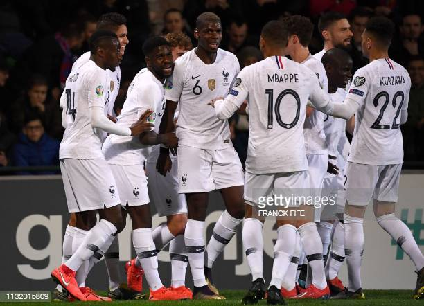 France's defender Raphael Varane is congratulated by teammates after scoring a goal during the Euro 2020 qualifying football match between Moldova...