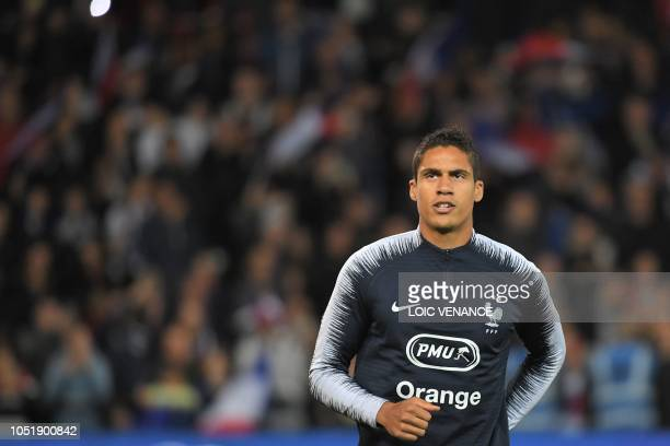 France's defender Raphael Varane warms up ahead of the friendly football match between France and Iceland at the Roudourou Stadium in Guingamp...
