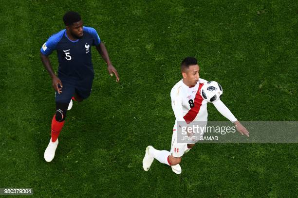 France's defender Samuel Umtiti and Peru's midfielder Christian Cueva compete for the ball during the Russia 2018 World Cup Group C football match...