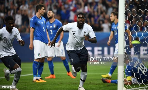 France's defender Samuel Umtiti celebrates after scoring a goal during the friendly football match between France and Italy at the Allianz Riviera...