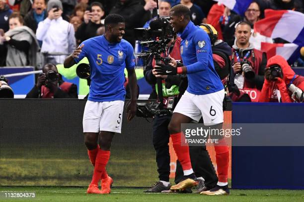 France's defender Samuel Umtiti celebrates after scoring a goal with France's midfielder Paul Pogba during the UEFA Euro 2020 Group H qualification...