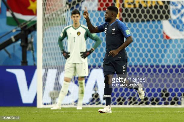 France's defender Samuel Umtiti celebrates after scoring the opener during the Russia 2018 World Cup semifinal football match between France and...