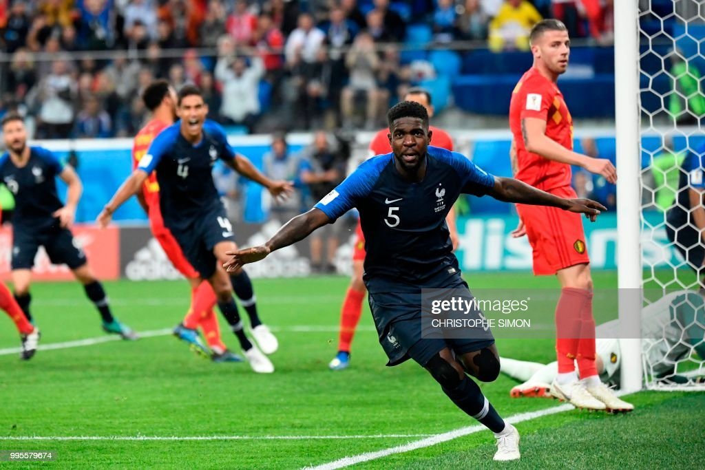 TOPSHOT - France's defender Samuel Umtiti celebrates scoring the opening goal during the Russia 2018 World Cup semi-final football match between France and Belgium at the Saint Petersburg Stadium in Saint Petersburg on July 10, 2018. (Photo by CHRISTOPHE SIMON / AFP) / RESTRICTED