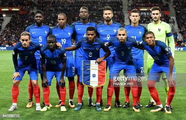 France's defender Samuel Umtiti defender Djibril Sidibé midfielder Paul Pogba forward Olivier Giroud defender Laurent Koscielny and goalkeeper Hugo...