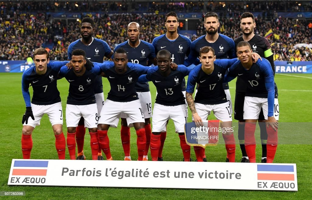 France's defender Samuel Umtiti, defender Djibril Sidibe, defender Raphael Varane, forward Olivier Giroud and goalkeaper Hugo Lloris, (bottom from L) France's forward Antoine Griezmann, midfielder Thomas Lemar, midfielder Blaise Matuidi, midfielder N'Golo Kante, defender Lucas Digne and forward Kylian Mbappe pose during the friendly football match between France and Colombia at the Stade de France, in Saint-Denis, on the outskirts of Paris, on March 23, 2018. /