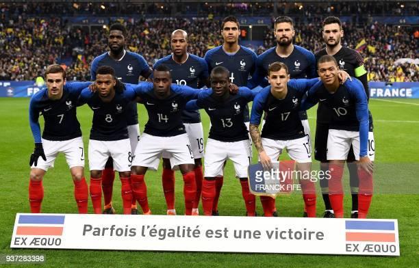 France's defender Samuel Umtiti defender Djibril Sidibe defender Raphael Varane forward Olivier Giroud and goalkeaper Hugo Lloris France's forward...
