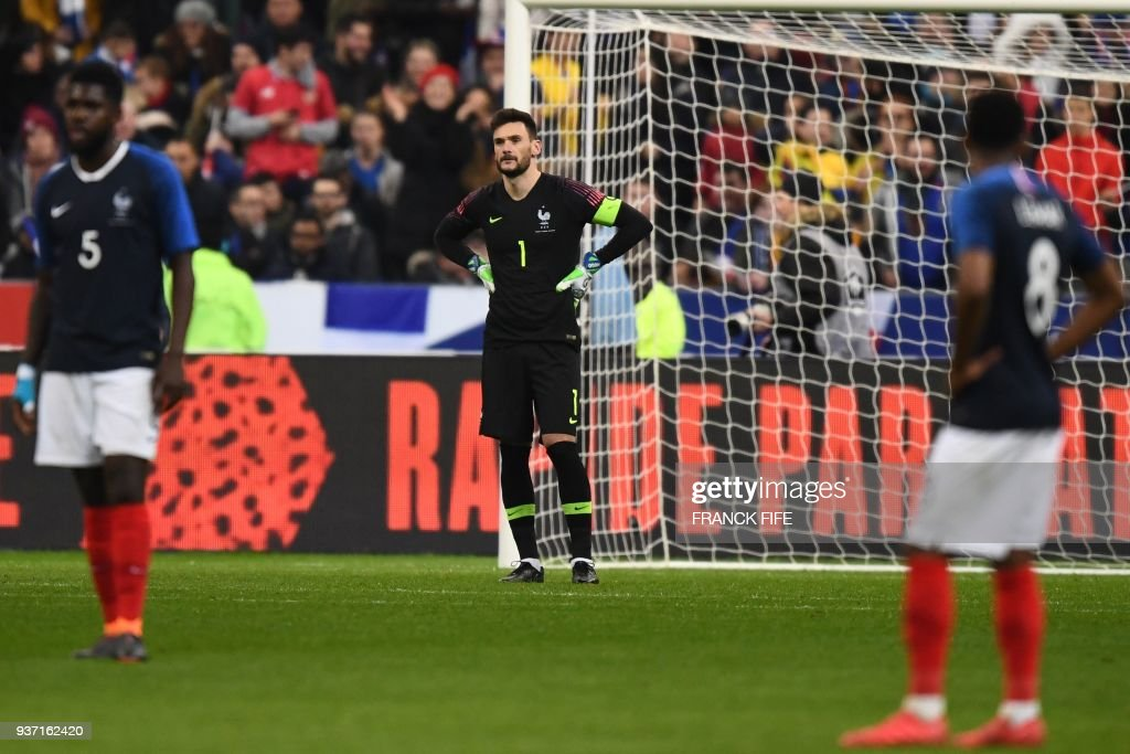 TOPSHOT - (From L) France's defender Samuel Umtiti, France's goalkeeper Hugo Lloris and France's midfielder Thomas Lemar react at the enf of the friendly football match between France and Colombia at the Stade de France, in Saint-Denis, on the outskirts of Paris, on March 23, 2018. /