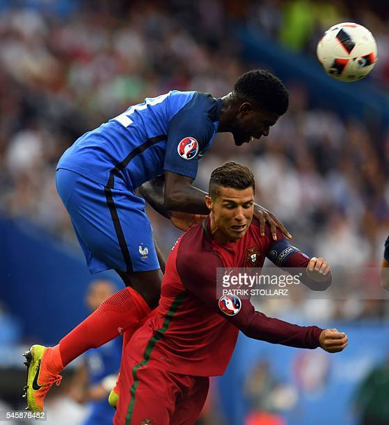 France's defender Samuel Umtiti heads the ball past Portugal's forward Cristiano Ronaldo during the Euro 2016 final football match between Portugal...
