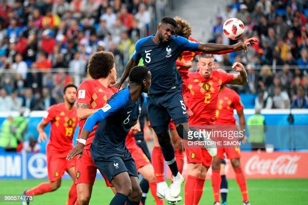 France's defender Samuel Umtiti heads the ball to score the opening goal during the Russia 2018 World Cup semi-final football match between France...