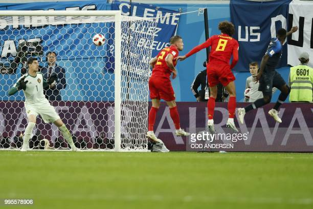 France's defender Samuel Umtiti heads to score the opener during the Russia 2018 World Cup semifinal football match between France and Belgium at the...
