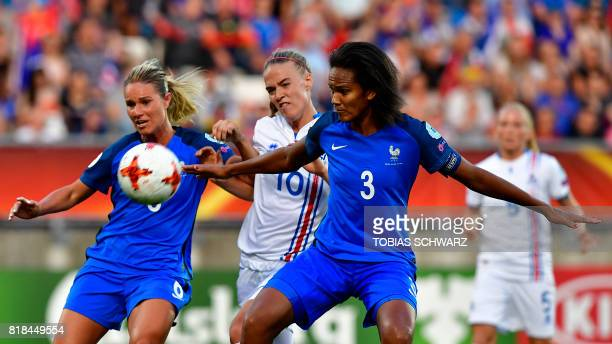 France's defender Wendie Renard and France's forward Eugenie Le Sommer vie with Iceland's midfielder Dagny Brynjarsdottir during the UEFA Women's...