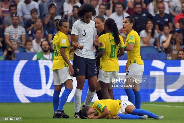 TOPSHOT France's defender Wendie Renard argue with Brazilian players after a foul on Brazil's forward Debinha during the France 2019 Women's World...