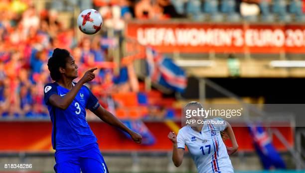 France's defender Wendie Renard heads the ball next to Iceland's midfielder Agla Maria Albertsdottir during the UEFA Women's Euro 2017 football match...